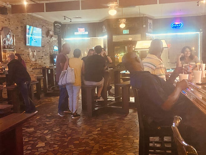 A crowd enjoys the reopening of Beer Belly's Saturday. Iberville Parish was the first parish in the Baton Rouge region to be given the go-ahead to reopen after a shutdown in August due to the pandemic.