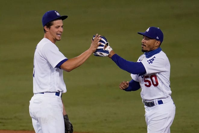 Corey Seager, left, Mookie Betts and the Los Angeles Dodgers open the National League wild-card playoffs Wednesday night hosting the Milwaukee Brewers.
