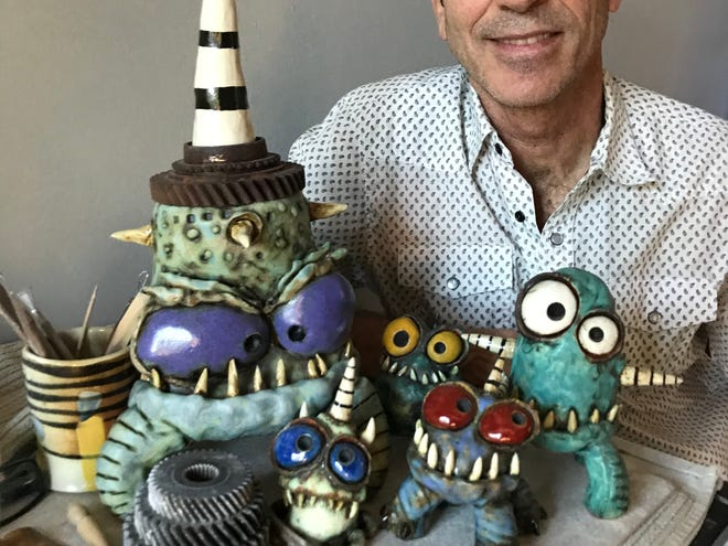Clay Fest 2020 sculptor James DeRosso with a few of his wily, wacky ceramic monsters.