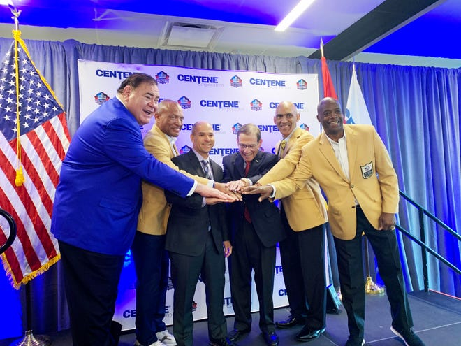 (Left to right) Pro Football Hall of Fame President and CEO David Baker, Hall of Famer Aeneas Williams, two representatives of Centene Corp., and Hall of Famers Tony Dungy and Darrell Green pose for photo. Centene and the Hall of Fame have partnered for wellness programs.