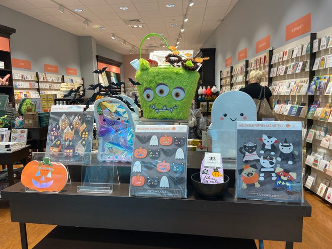 Halloween merchandise at Paper Source at the Mall at University Town Center in Sarasota. The National Retail Federation expects that overall spending on Halloween will be down this year, but spending per person will increase slightly.