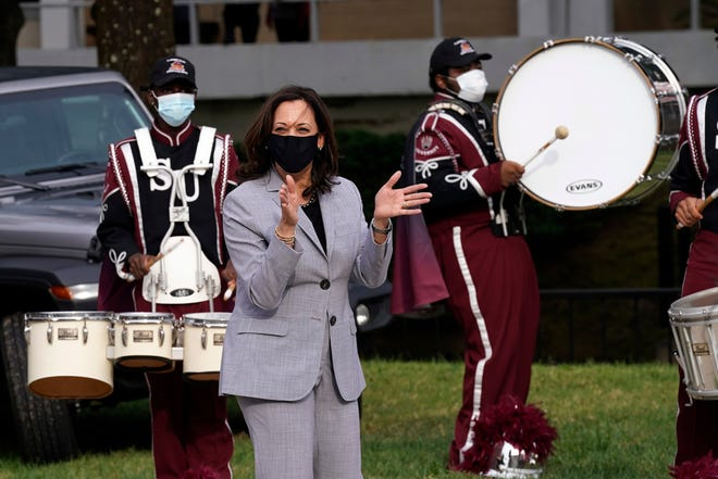 Democratic vice presidential candidate Sen. Kamala Harris, D-Calif., claps with the band at Shaw University during a campaign visit in Raleigh, N.C., Monday, Sept. 28, 2020. (AP Photo/Gerry Broome