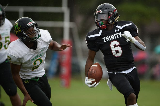 Trinity Christian's Xavier Tubbs-Matthews (6) rushed for 92 yards and a pair of touchdowns to help the Crusaders earn a 36-20 win at Ravenscroft on Friday night. Trinity's running backs accounted for more than 260 yards on the ground.