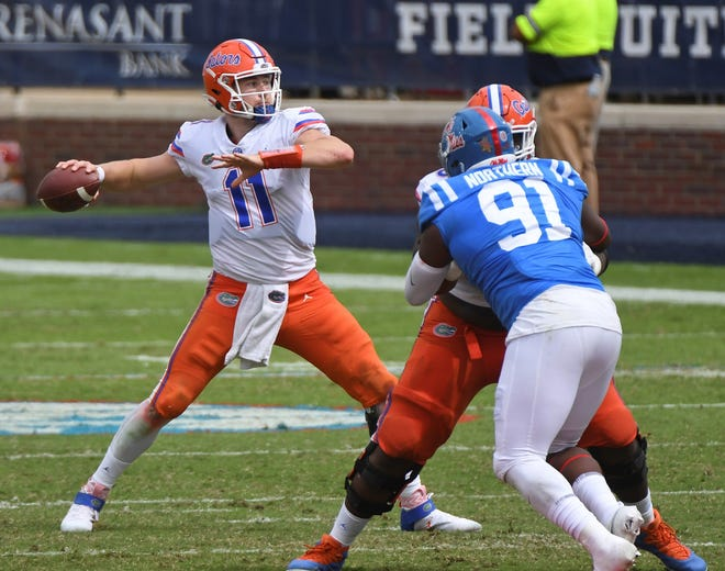 Florida quarterback Kyle Trask looks to pass during the second half Saturday against Mississippi in Oxford, Miss. Trask passed for 416 yards, the most by a UF quarterback during an SEC game since Rex Grossman in 2001, in the win.