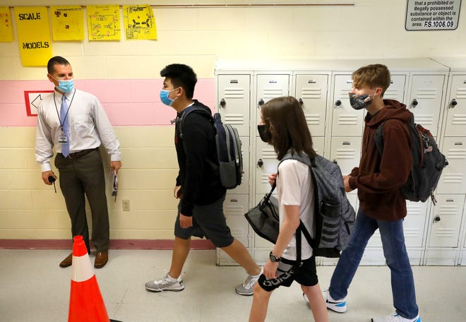 Students walk through a hallway at Ft. Clarke Middle School in Gainesville.