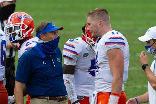 Florida coach Dan Mullen, left, said the team is building up to Saturday's return to action.