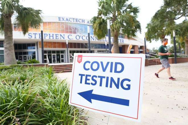 A University of Florida student leaves the O'Connell Center after taking a COVID-19 test at the arena.