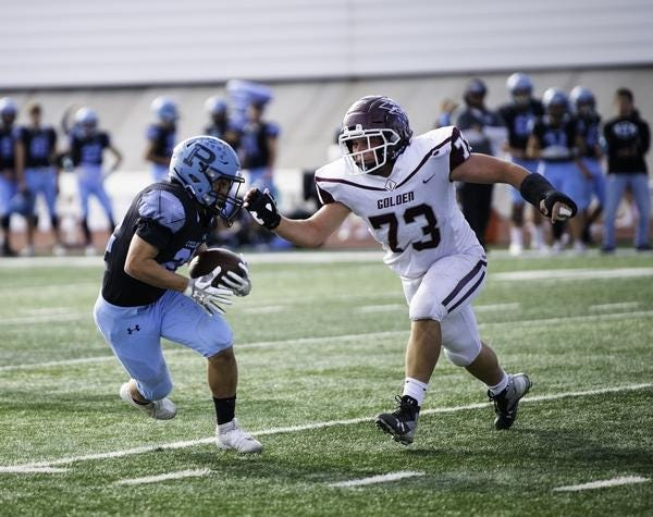 Pueblo West High School junior Jeremiah Sanchez jukes a Golden defender during the Cyclones' playoff win last November. Sanchez will battle for the starting quarterback position in 2020.