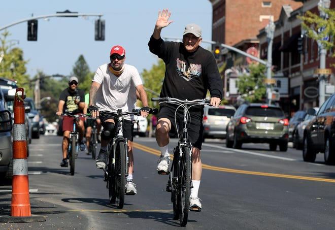 Westerville native Steve Schwier, left, rides into Uptown Westerville with his father, Jim Schwier of Westerville, and friends to complete his 1,300-mile e-bike ride from Denver to Westerville on Sept. 25 to raise awareness and money for Meniere's disease research. Meniere's disease, which Schwier has, attacks the inner ear, causing vertigo, tinnitus and permanent hearing loss among its symptoms.