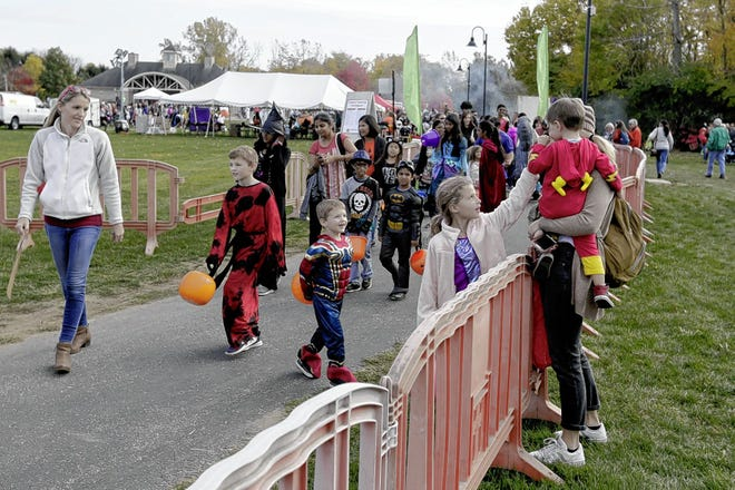 Children line up to traverse the Trunk-or-Treat Trail during the 2019 Dublin Halloween Spooktacular at the Dublin Community Recreation Center. Because of the COVID-19 coronavirus pandemic, the city is planning different activities this year.