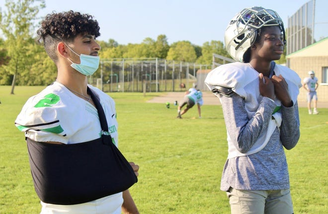 Scioto senior Ibby Abumallouh (left) entered the preseason contending for the starting quarterback position with Amare Jenkins. Injuries have sidelined Abumallouh, but he remains with the Irish to support his teammates.