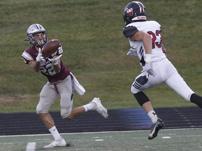Columbus Academy's Sam Huyghe makes a catch in front of Liberty Union's Hunter Putnam and runs in for a touchdown during their game at Academy on Sept. 25. The Vikings won 41-15.