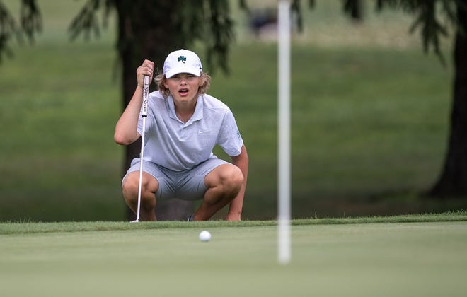 Coffman junior Drew Keyser sizes up a putt on the 10th green during the first round of the OCC-Central Division tournament Aug. 12 at Turnberry. Keyser has been a key contributor for the Shamrocks.
