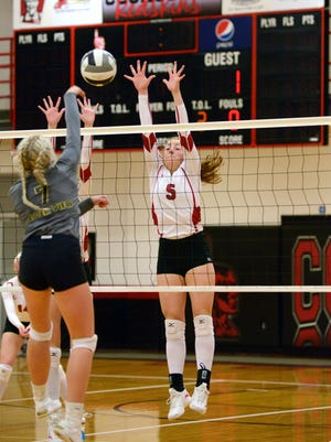 Coshocton's Kindall Shaw goes up for a block against River View's Carolyn Cox in a match earlier this season, Shaw was a unanimous first-team selection for the Small School squad.