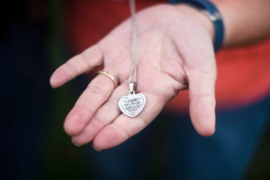 "Bret and Caroyle Andrews said they usually don't Christmas shop in advance, but Bret purchased a ""Dad Loves You"" necklace for his daughter, Abbie Eichman, in the spring, months before he would have gifted it to her. Abbie, 36, died of COVID-19 on July 3."