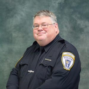 Troy Communications Officer Curtis Reynolds suffered a fatal heart attack on Sept. 19, his 50th birthday.