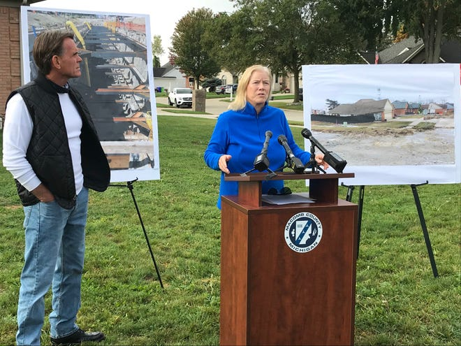 Macomb County Public Works Commissioner Candice Miller announces $12.5 million settlement in 2016 Fraser sinkhole Christmas Eve day. At left is Macomb County Executive Mark Hackel.