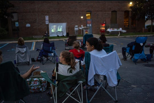 """Movie-goers gather in the parking lot of the Fraser Public Library to watch """"Mamma Mia!"""" on Sept. 26, 2020, in Fraser."""
