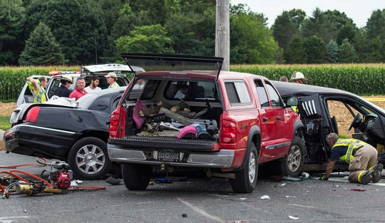 In this July 18, 2015, file photo, authorities investigate the scene of a fatal crash between a limousine and pickup truck in Cutchogue, N.Y.
