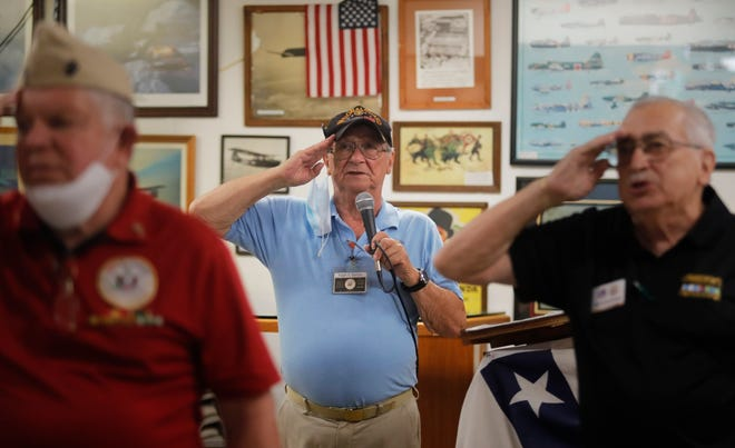 Ralph Santillo, center, leads guests in the Pledge of Allegiance, Tuesday, Sept. 29, as staff and volunteers hosted their final luncheon for veterans at the museum. The Southwest Florida Military Museum and Library will be closing Wednesday, September 30, 2020 after a bitter dispute with its former business partner. Now its organizers are figuring out what to do next, including possibly finding a new space.