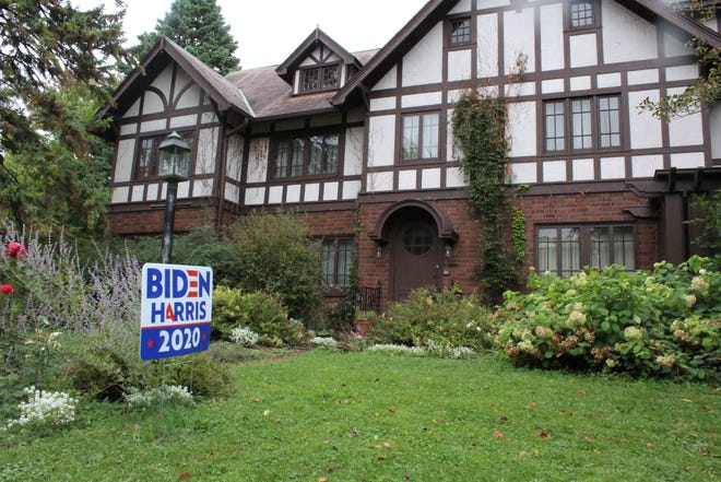 Joseph Dobson placed his new Biden-Harris 2020 sign next to a light in his yard on South Madison Street after the previous sign was stolen.