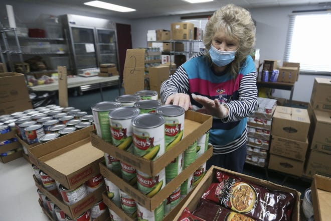 Volunteer Vivian Giese organizes inventory  at the Community Thrift Store of Portage County in Stevens Point.