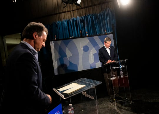 Gov. Steve Bullock, left, and U.S. Sen. Steve Daines, R-Mont., prepare their notes before the beginning of their televised debate at the KUFM-TV studio at the University of Montana on Monday, Sept. 28, 2020, in Missoula, Mont. (Ben Allan Smith/The Missoulian via AP)