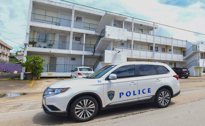 A Guam Police Department vehicle drives through a Tamuning neighborhood after a reported shooting incident nearby on Tuesday, Sept. 29, 2020.