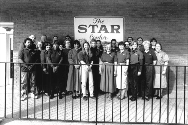 Judy Duke, seen fourth from the right in this 1995 staff photo, has been with The Star Center since 1991.