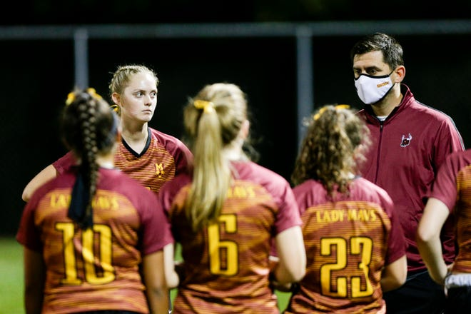 McCutcheon head coach Branko Isailovic talks with his team after being defeated by Lafayette Jeff, 1-0, Monday, Sept. 28, 2020 in Lafayette.
