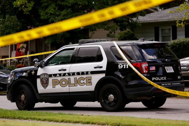 Crime scene tape drapes across a Lafayette Police Department cruiser, Tuesday, Sept. 29, 2020 in Lafayette.