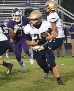 Lancaster's Caleb Sampson runs the ball during the Golden Gales' 35-0 loss against Pickerington Central in Week 5. The Golden Gales will host Newark Friday at Fulton Field.