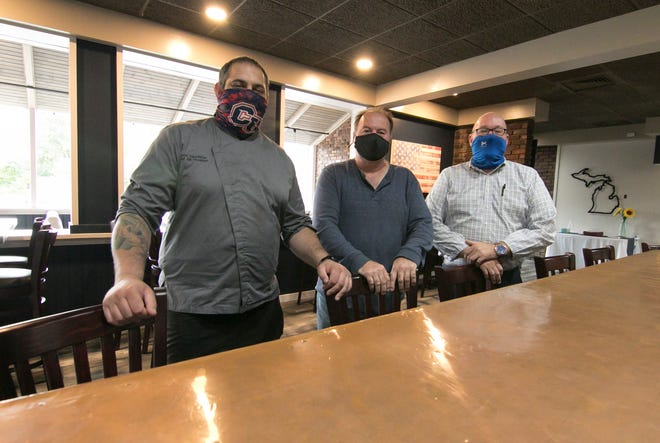 Chef Chris Landells, left, restaurant co-owner Dan Russell, center, and general manager Joe Matley, shown Tuesday, Sept. 29, 2020, show off the newly renovated Brunner's on the River, which will be renamed Copper River.