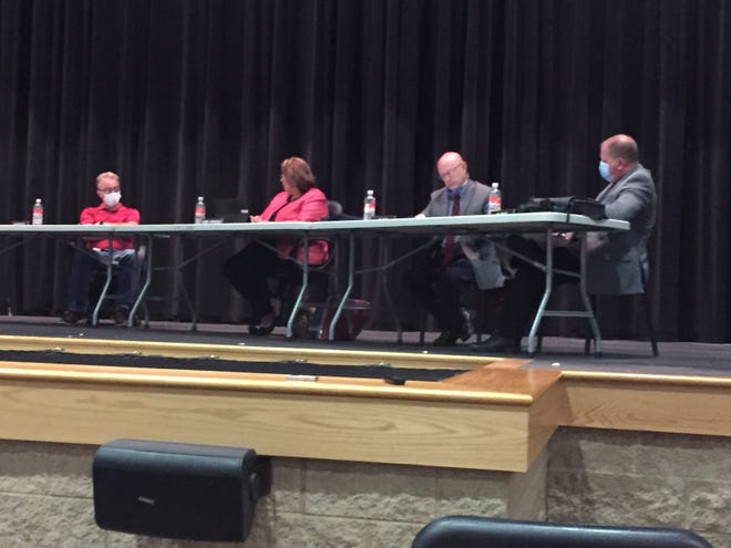 Shelby City Schools treasurer Barb Donohue, second from left, makes a point at Monday's school board meeting.