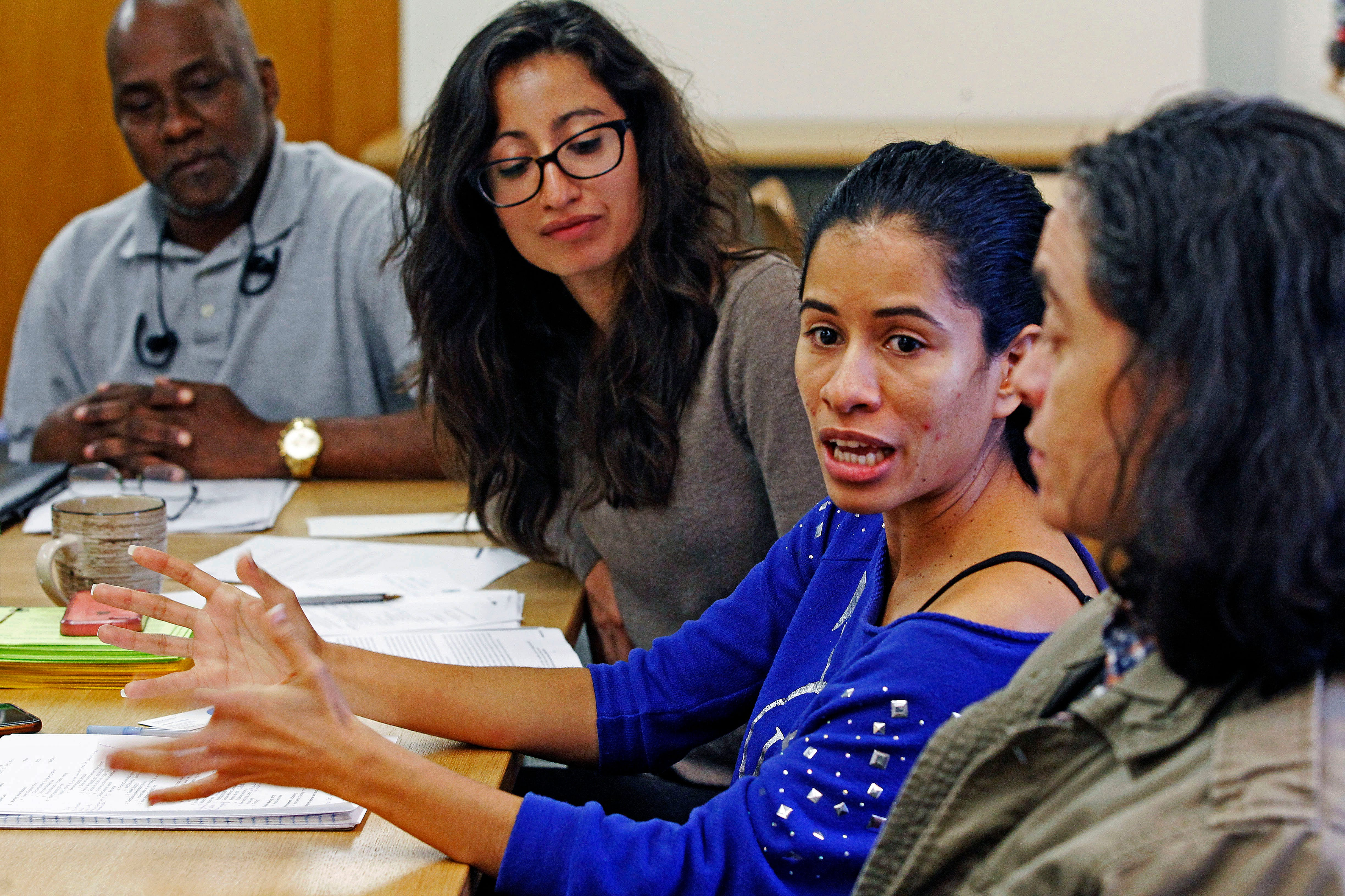 Lorena Lopez,  center in blue dress, from the Right to Counsel NYC Coalition Steering Committee, talks about the work the agency does do on Oct. 8, 2019, in New York.  Also pictured from left are Randy Dillard, Alyssa Figueroa and Sandra Contreras.