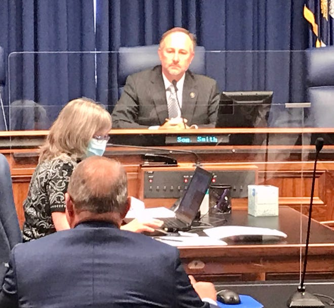 Senate Judiciary B Chairman Gary Smith, D-Norco, listens as Senate President Page Cortez, R-Lafayette (back to camera), testifies about his bill to curtail a governor's executive power during an emergency.