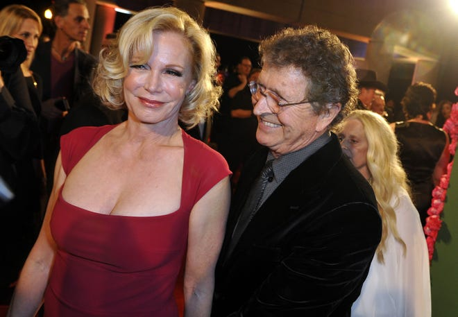 Mac Davis, right, arrives on the red carpet with his wife Lise Kristen Gerard for the 63rd annual BMI Country Awards show Nov. 3, 2015.