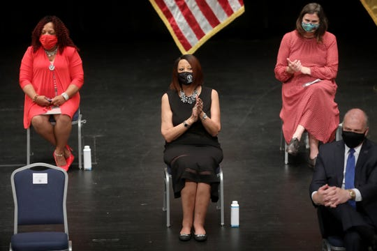 Lieutenant Governor Sheila Oliver (center) and others wear masks inside the Patriots Theater at the Trenton War Memorial, for the budget signing. Tuesday, September 29, 2020