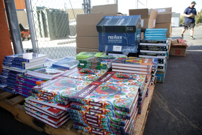 Textbooks sit behind Desert Hot Springs High School for distribution during a senior drive-thru for various school materials on Monday, September 29, 2020, in Desert Hot Springs, Calif.