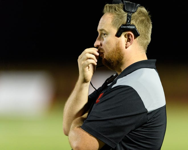 Combs head coach Travis Miller on the sideline of their high school football game on Friday, Sept. 15, 2017, at Seton Catholic High School in Chandler, Ariz.