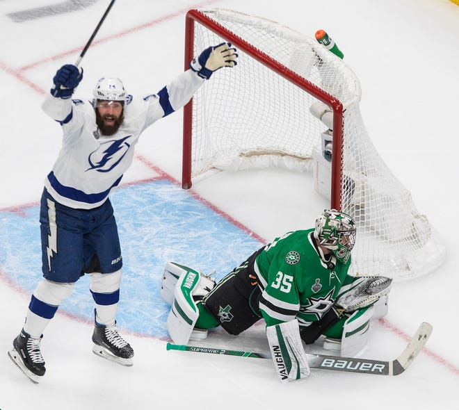 Tampa Bay Lightning's Pat Maroon (14) reacts as the puck goes past Dallas Stars goalie Anton Khudobin (35) during second-period NHL Stanley Cup finals hockey game action in Edmonton, Alberta, Monday, Sept. 28, 2020. (Jason Franson/The Canadian Press via AP)