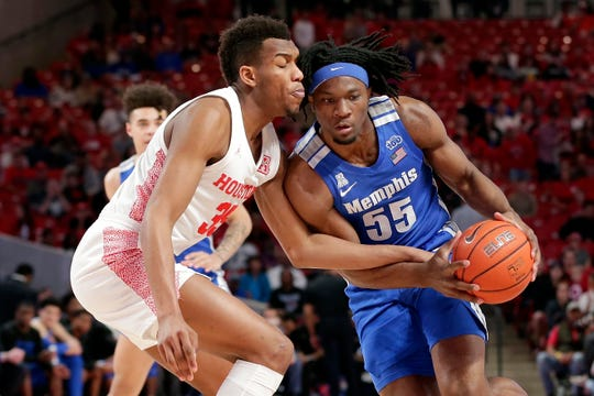 Houston forward Fabian White Jr. (35) reaches in as Memphis forward Precious Achiuwa (55) drives to the basket during the first half of an NCAA college basketball game Sunday, March 8, 2020, in Houston. (AP Photo/Michael Wyke).