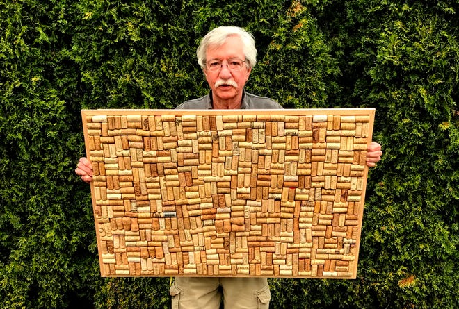A cork board, displayed by the proud creator.