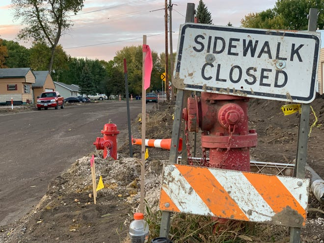 Road construction signs on 4th Street and Washington Avenue on Monday, Sept. 28, 2020.
