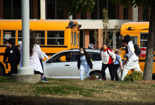 Students leave at the end of the school day on Tuesday, September 29, at Lincoln High School in Sioux Falls.