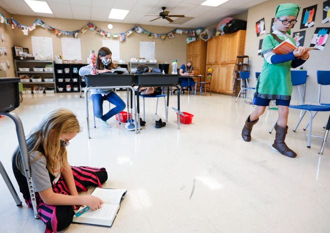 Students take part in a reading assignment in a class at Fair Grove Elementery School on Thursday, Sept. 24, 2020.