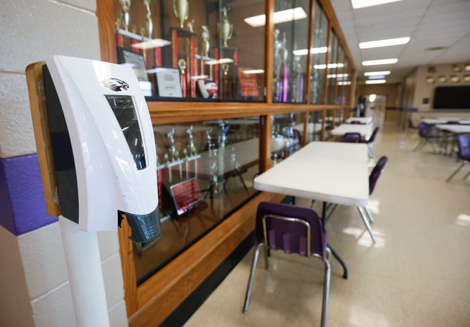 A hand sanitizing station in the gymnasium lobby at Fair Grove High School that has been converted into a second lunchroom to allow more space for social distancing.