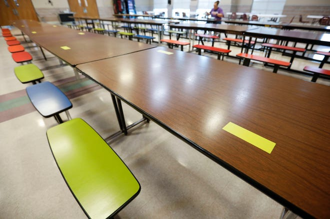 Tables in the cafeteria at Fair Grove schools have every other seat marked off to encourage social distancing due to COVID-19.