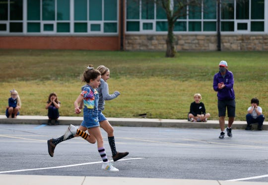 Fair Grove elementary school students compete in a race outside the school on Thursday, Sept. 24, 2020.