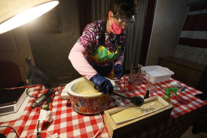 Gwinda Kelly, owner of Kelly's Hilltop Goats, fills a mould for making bars of soap in her home near Zanesville. Kelly makes the soap using natural ingredients, including goat's milk.